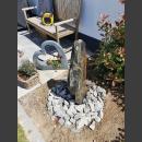 Schiefer Monolith graubraun